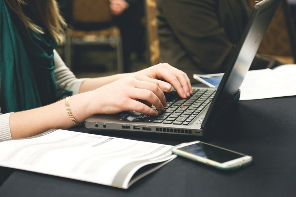 How to edit your own writing - content marketing for online business owners. Photo of a lady typing on a laptop.